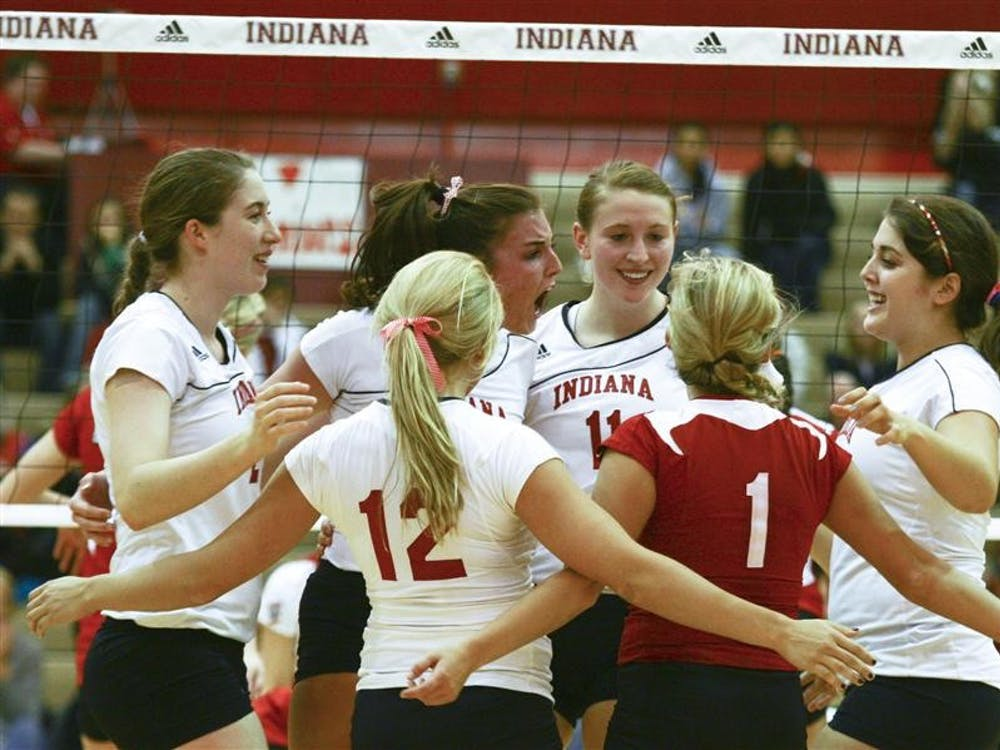 The Hoosiers celebrate a point against Wisconsin on Nov. 27 in University Gym.