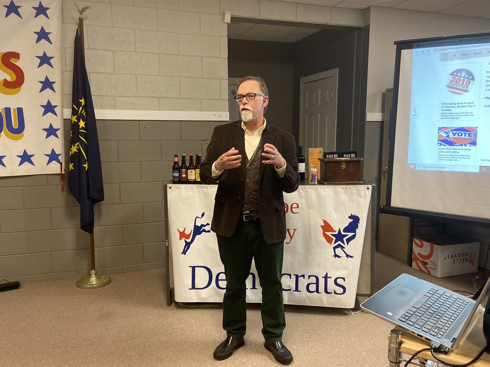 Ron Smith gives a speech to Democratic supporters Tuesday night after he was declared the unofficial winner for the Bloomington City Council District 3 seat at the Monroe County Democrats watch party. Smith won with 448 votes.