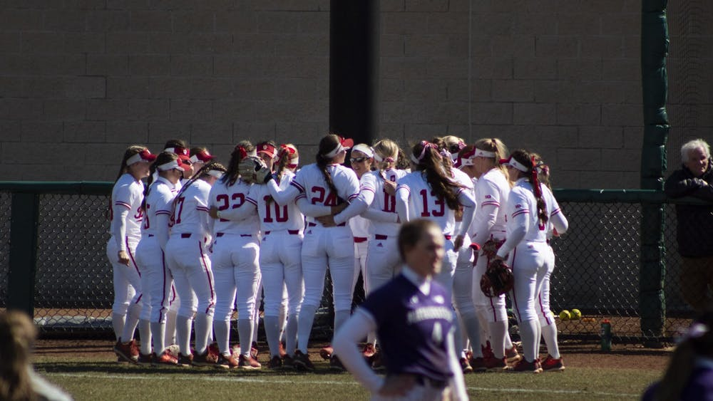 The IU softball team huddles before a game March 16, 2019. The Hoosiers will play Michigan on Friday at home.