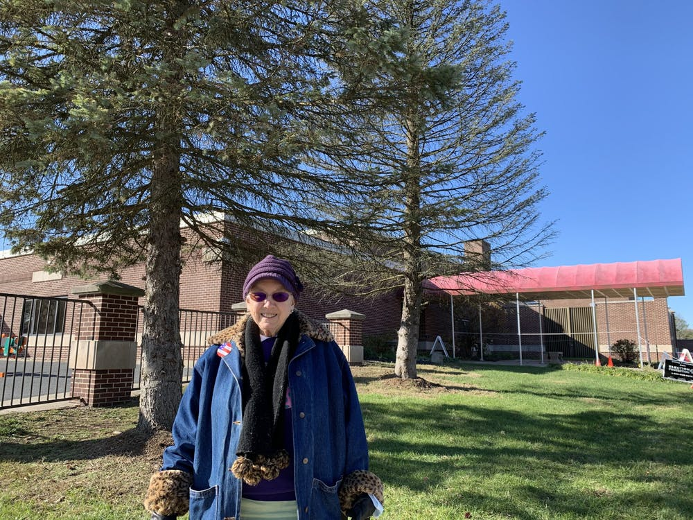 """Former nurse Pauline Caldwell, 82, poses Nov. 3 outside University Elementary School. """"Part of my family is split,"""" Caldwell said, """"so I vote without talking about it."""""""