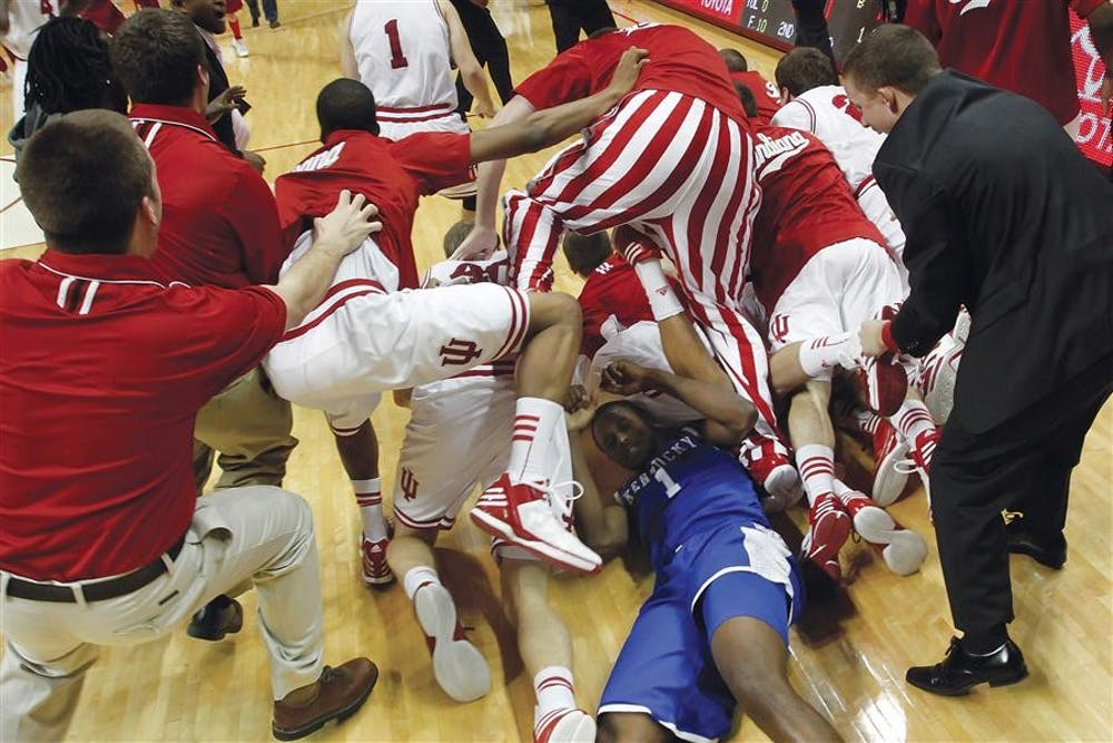 IU players storm the court and jump over Kentucky's Darius Miller (#1) and onto Christian Watford after he made the game winning basket against Kentucky on Dec. 10, 2011 at Assembly Hall. Kentucky was ranked #1 in the country.