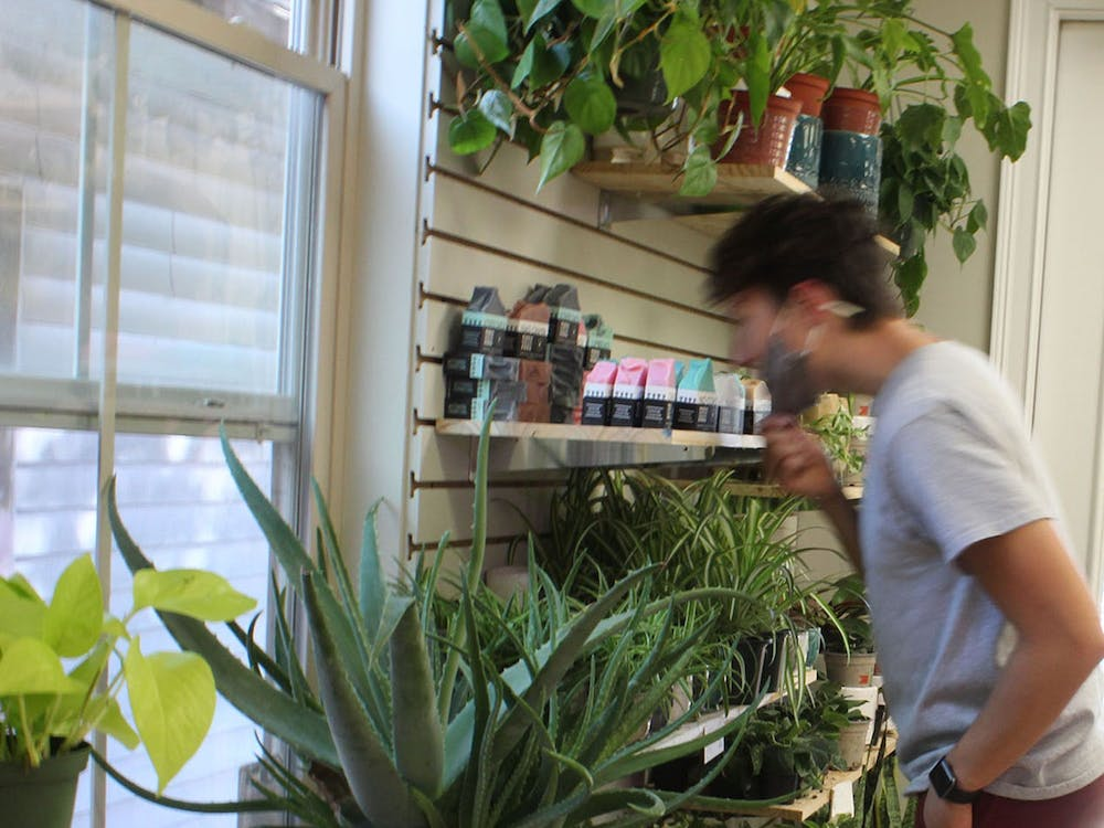 A customer pulls down his mask to sniff a row of organic soaps made by Perennial Soaps. According to their website, their soap recipe consists of plant-based ingredients and oils and is free of unnecessary chemicals.