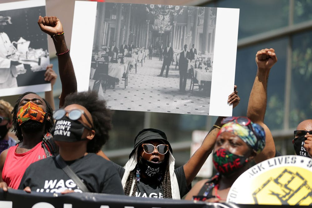Tsehaitu Abye, center, Pennsylvania organizer for One Fair Wage, chants during a rally as part of the national Strike for Black Lives on July 20 in Philadelphia. The group was demanding legislation that would provide PPE, essential pay and extended unemployment benefits.