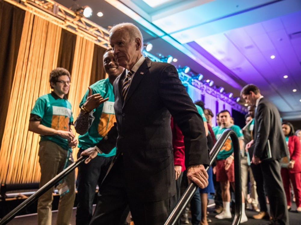 Former Vice President Joe Biden exits the stage after delivering a speech about sexual assault. The Association of Fraternal Leadership and Values conference was Friday at the JW Marriott in Indianapolis.