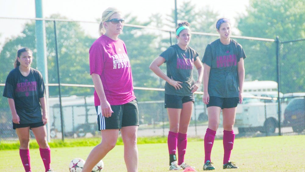IU Head Coach Amy Berbary stands with players during practice Wednesday. Berbary begins her first season as head coach at IU, previously spending five seasons as an assistant coach and associate head coach at Auburn University.