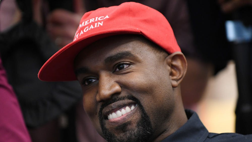Musician Kanye West looks on in the Oval Office of the White House during a meeting with President Donald Trump on Oct. 11, 2018, in Washington, D.C.