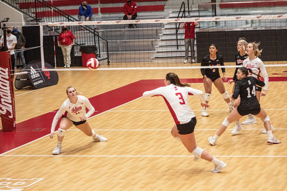 <p>Freshman outside hitter Tommi Stockham and junior outside hitter Breana Edwards go for the ball Jan. 23 in Wilkinson Hall. The Hoosiers went 1-1 for the weekend against Rutgers, losing their Friday match 1-3 and winning their Saturday match 3-1 in Piscataway, New Jersey. </p>