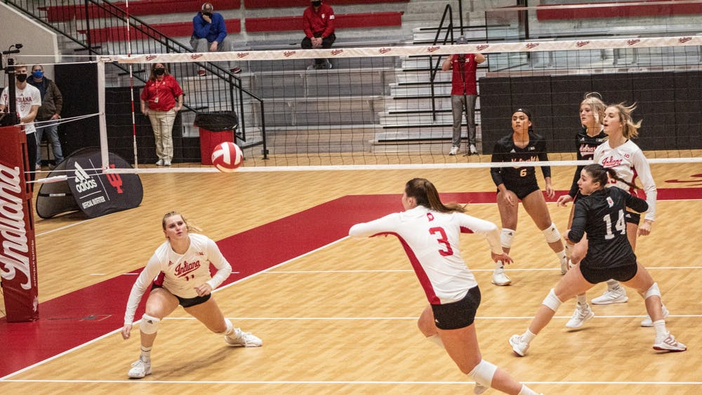 Freshman outside hitter Tommi Stockham and junior outside hitter Breana Edwards go for the ball Jan. 23 in Wilkinson Hall. The Hoosiers went 1-1 for the weekend against Rutgers, losing their Friday match 1-3 and winning their Saturday match 3-1 in Piscataway, New Jersey.