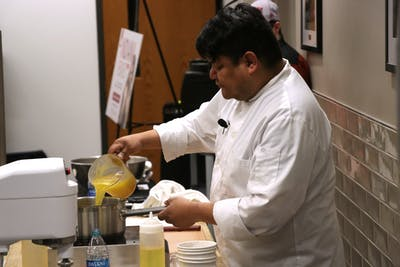 Native American chef Freddie Bistoie pours broth into a pan Feb. 19 in the Bookmarket Eatery in Wells Library. Bistoie gave a cooking demonstration  as part of the Indiana Remixed series.