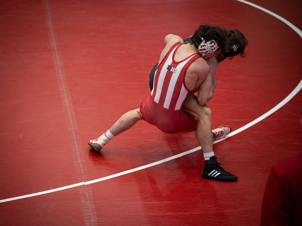 IU sophomore Matt Ortiz attempts to take down Caleb Licking at Wilkinson Hall on Feb. 6. IU wrestling will compete against Purdue at 8 p.m. Monday.