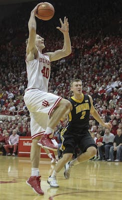 Then-sophomore Cody Zeller leaps for a dunk against Iowa on Mar. 2, 2013 at Assembly Hall. Zeller will be entering the 2013 NBA draft on June 27.