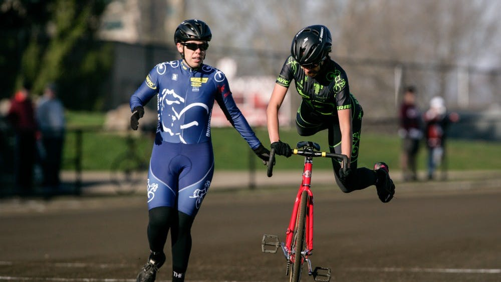 Kappa Alpha Theta riders perform an exchange during Little 500 qualifications Saturday morning at Bill Armstrong Stadium. Kappa Alpha Theta finished first in quals. with a time of 2:36.63.