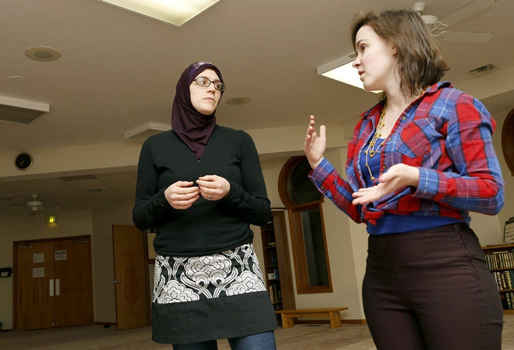 Anna Maidi, left, and Aubrey Seaders talk Monday at Islamic Center. They have recently produced a project Muslims of Bloomington, consists of two smaller projects, The Hijab Diaries and the Muslims of Bloomington Blog, to promote understanding of what Islam and Musliam Americans.