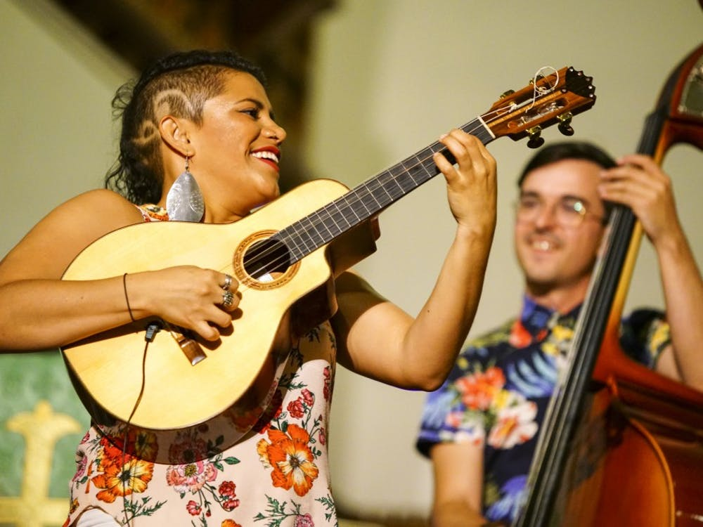 Mafer Bandola of Ladama plays a solo on the bandola llanera during the Lotus World Music and Arts Festival Saturday night in the First United Methodist Church. Ladama specializes in Pan-American music combining the styles of traditional Brazilian, Venezuelan and Colombian music with contemporary American pop and jazz.