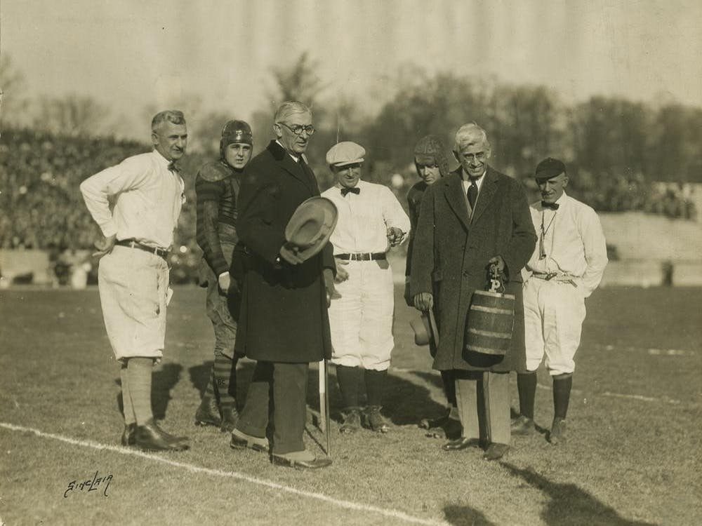 Members from IU and Purdue's football programs pose Nov. 21, 1925, with the Old Oaken Bucket trophy. The dedication of the brand new Tenth Street Stadium took place at 1 p.m. that day, and IU tied Purdue 0-0 in the football game.