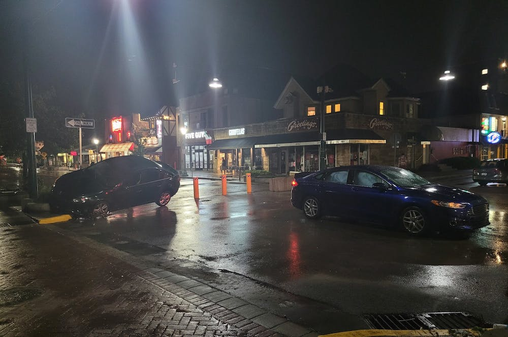 <p>Cars sit in the street after being damaged by flood waters Friday night early on Kirkwood Ave. Emergency responders reported 17 water rescues, according to a release from the City of Bloomington on Saturday.</p>