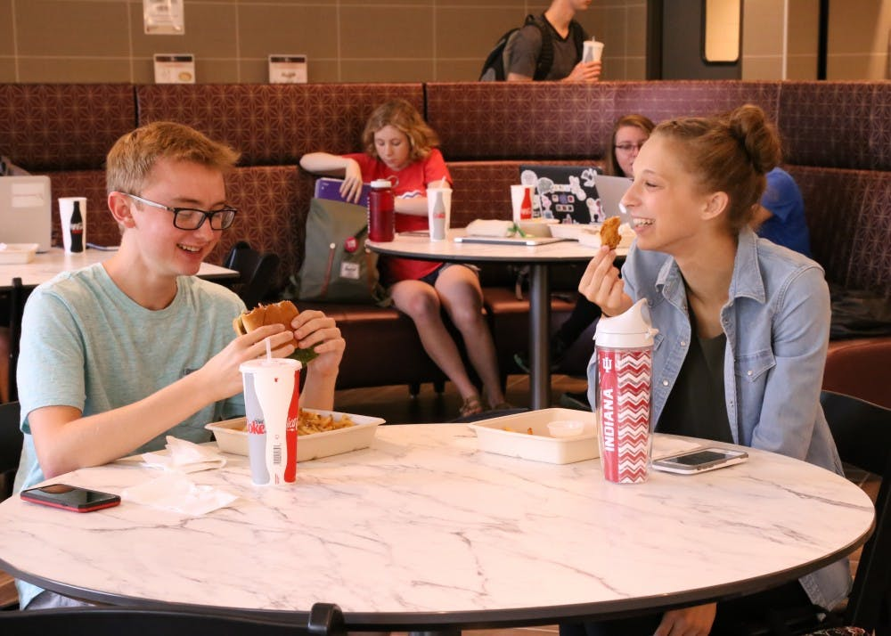 <p>Freshmen Andrew Lamparski (left) and Sarah Zygmuntowski (right) have lunch in the Goodbody Eatery. The new eatery officially opened Sept. 18.</p>