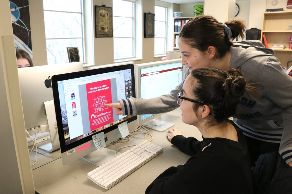 <p>Indiana Daily Student designers Lauren Koultourides and Cassia Chryssovergis proof LiveInBtown advertisements. The IDS creative team won three awards last weekend from the College Media Business and Advertising Managers annual contest.</p>
