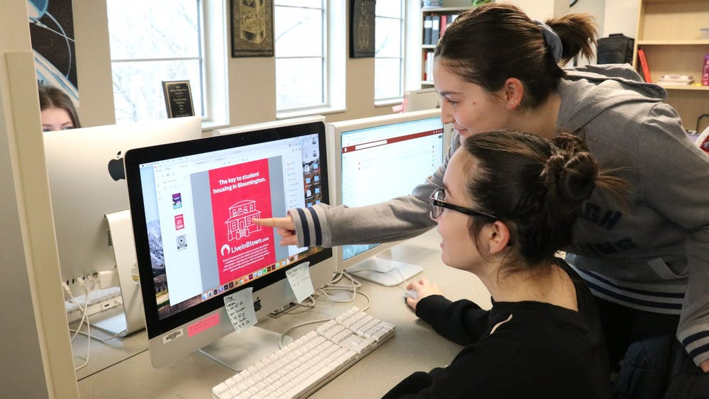 Indiana Daily Student designers Lauren Koultourides and Cassia Chryssovergis proof LiveInBtown advertisements. The IDS creative team won three awards last weekend from the College Media Business and Advertising Managers annual contest.