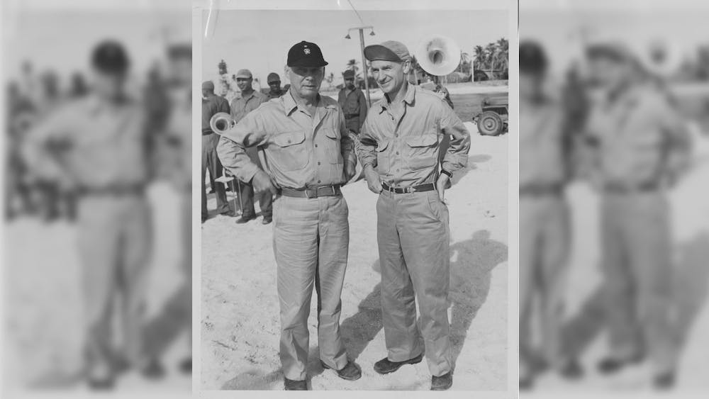 Ernie Pyle stands with Admiral Oliver O. Kessing in 1945. Pyle studied economics at IU before dropping out to take a journalism job in Indianapolis.
