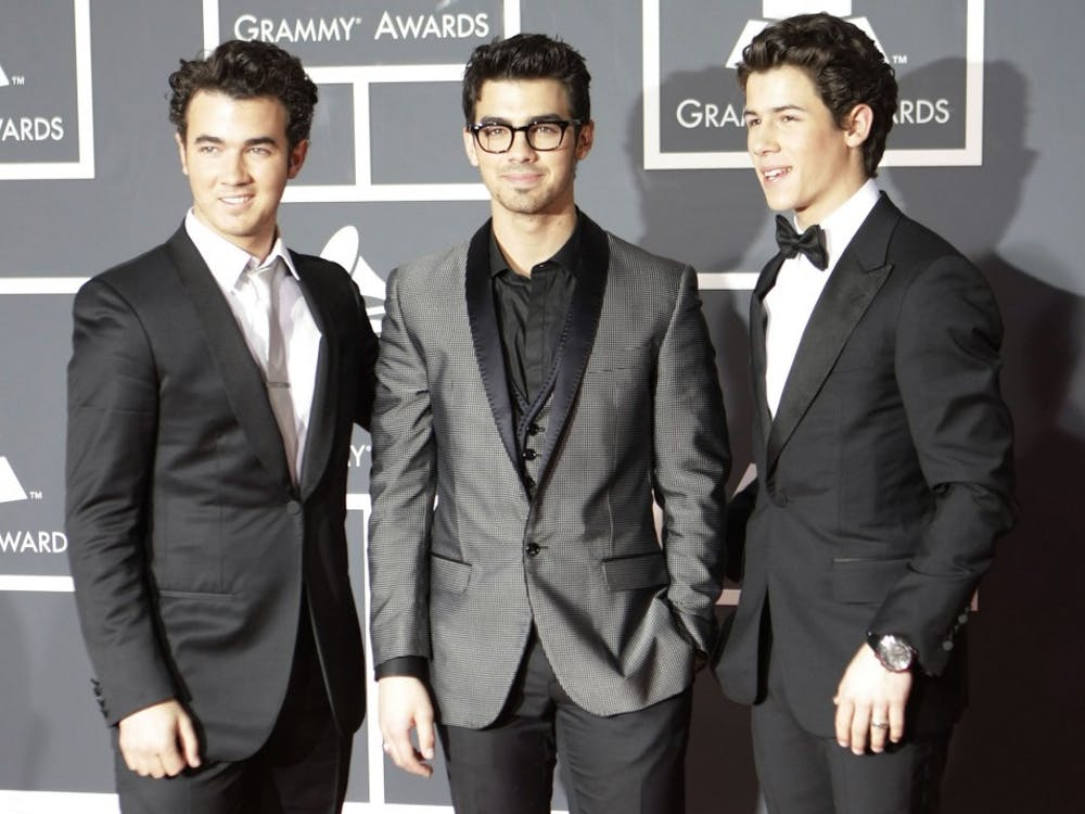 """The Jonas Brothers arrive at the 52nd Annual Grammy Awards in Los Angeles in 2010. After a long hiatus, the trio released a new song titled, """"Sucker."""""""