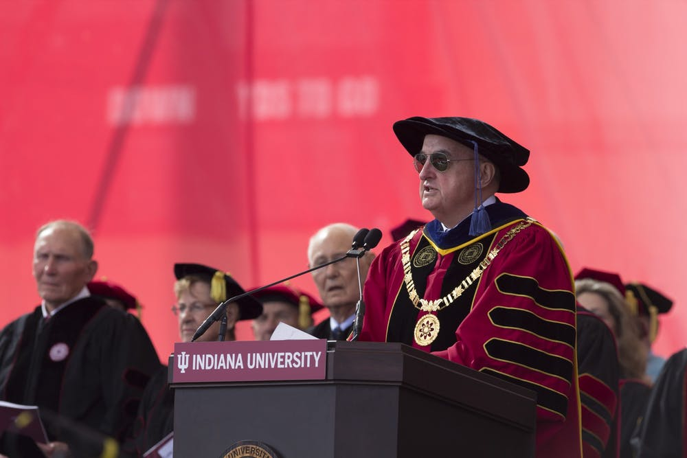 <p>President Michael A. McRobbie addresses undergraduates during their commencement May 5, 2018, in Memorial Stadium. Dr. Aaron Carroll, IU&#x27;s director of mitigation testing, said Thursday that all students must be tested twice for COVID-19 before attending the 2021 commencement ceremony.</p>