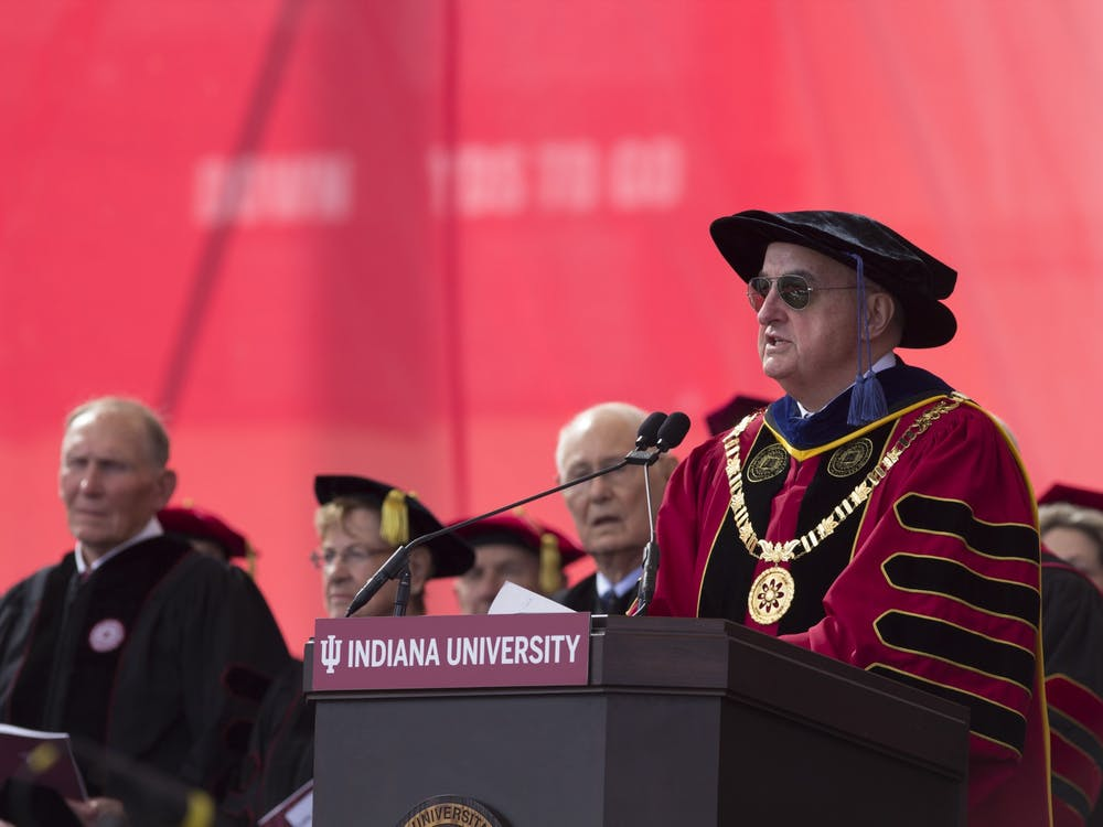 President Michael A. McRobbie addresses undergraduates during their commencement May 5, 2018, in Memorial Stadium. Dr. Aaron Carroll, IU's director of mitigation testing, said Thursday that all students must be tested twice for COVID-19 before attending the 2021 commencement ceremony.