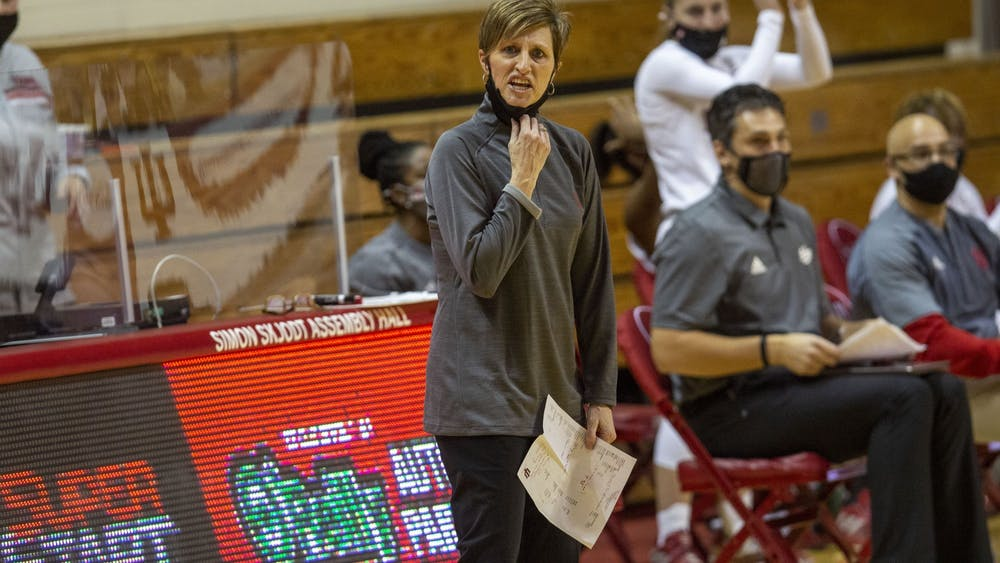 IU women's basketball head coach Teri Moren pulls down her mask to shout instructions in the game against the University of Tennessee on Dec. 17 in Simon Skjodt Assembly Hall. IU defeated Minnesota 75-54 on Wednesday.