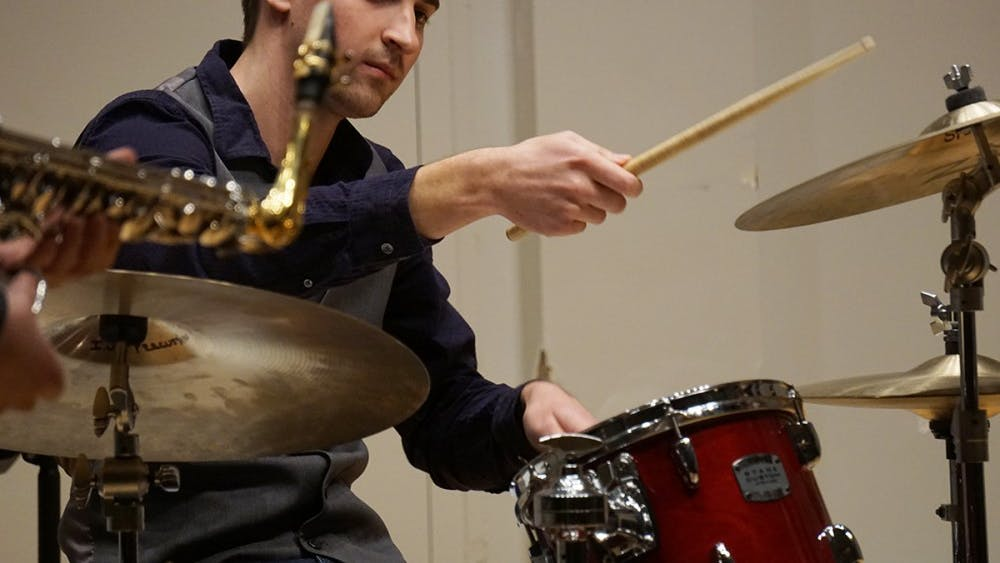 "Sophomore drummer Jarred Rusin strikes up a solo jazz beat from Soweto Kinch's ""Never Ending"" on Tuesday evening at Ford-Crawford Hall. The All-Campus Jazz Ensembles and Combos is directed by Ana Nelson and Barclay Moffitt."
