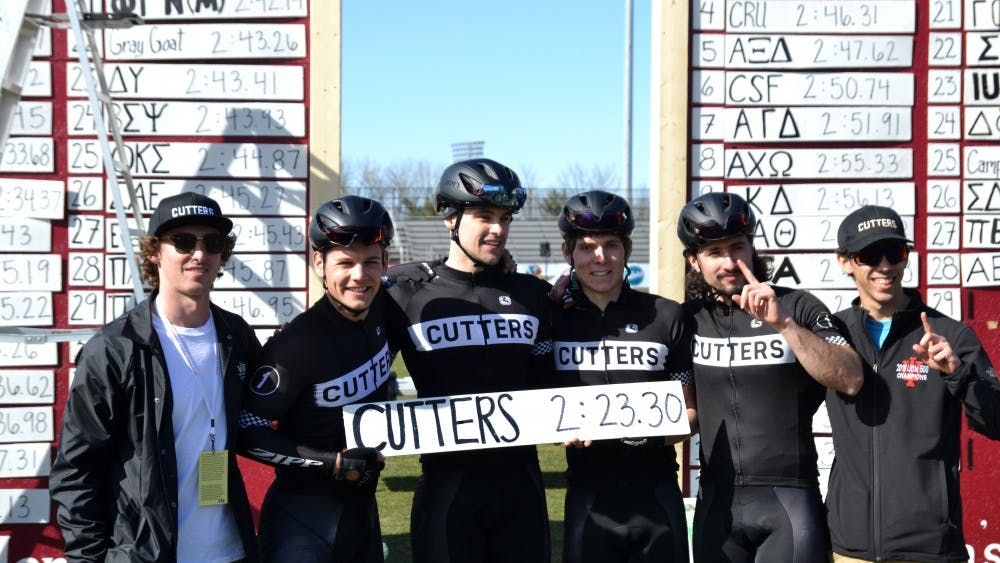 The Cutters pose with their race time Saturday at Little 500 Qualifications. The Cutters had the fastest time to qualify for the men's Little 500 race that takes place on April 13.