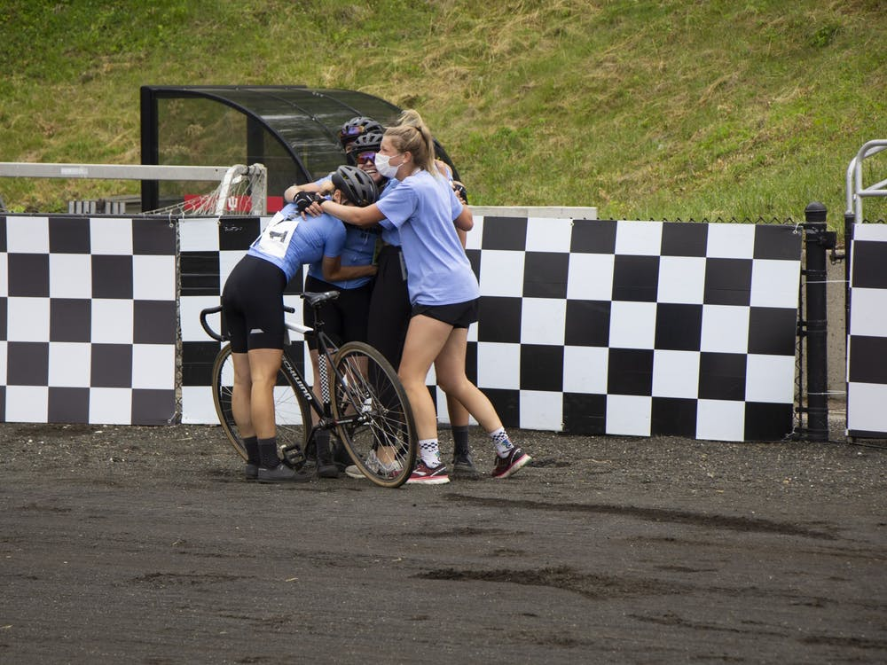 The Delta Gamma team hugs after the Women's Little 500 race Wednesday at Bill Armstrong Stadium. Delta Gamma won its fourth Little 500 race Wednesday.