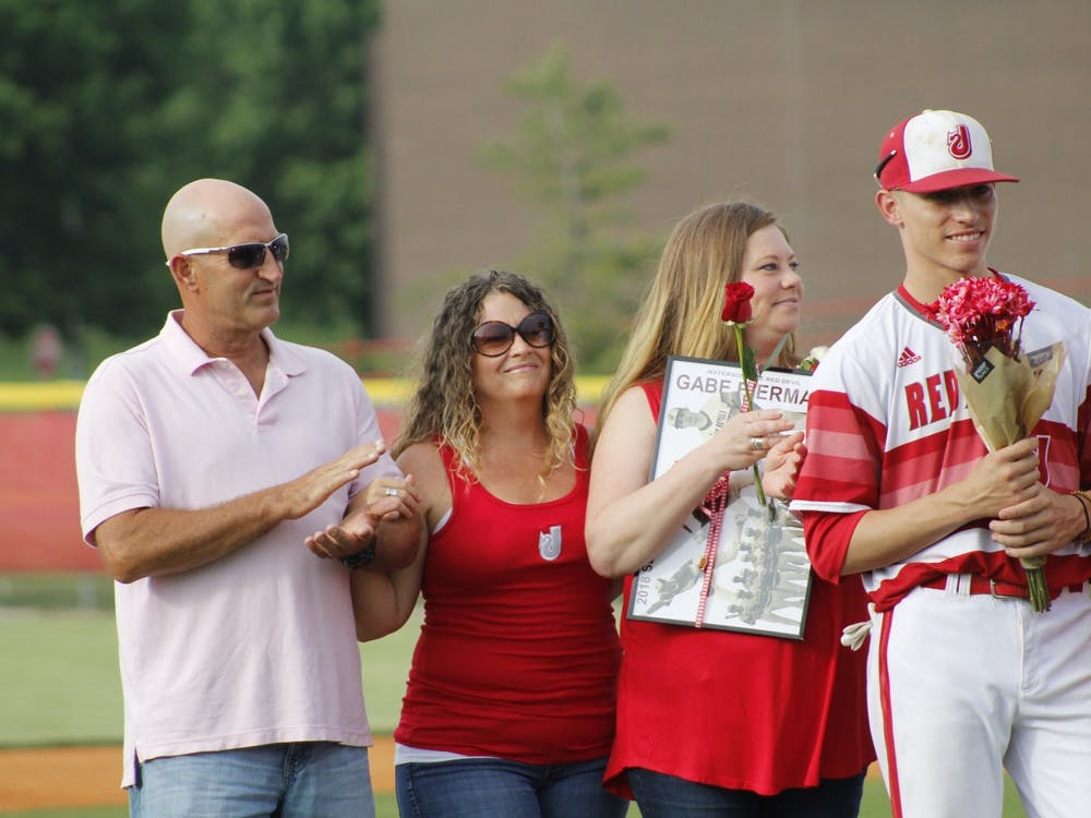 Gabe Bierman stands with his mother Andrea, stepmother Molly and father Douglas during his senior day celebration May 17, 2018, at Jeffersonville High School. Douglas died less than a year later on May 16, 2019, at the age of 49.
