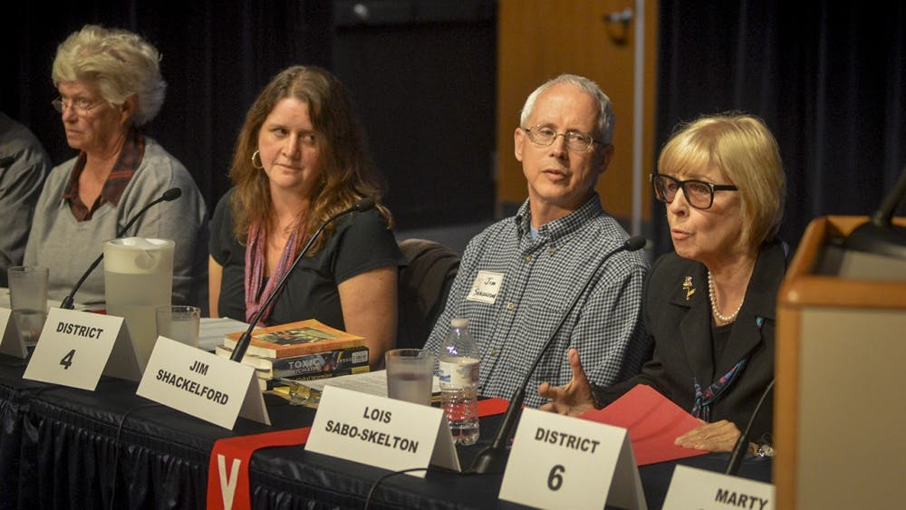 District 6 candidates Lois Sabo-Skelton and Marty Spechler debate on the topic of charter schools and their effects on public school funding during the Monroe County Community School Corporation meeting Thursday evening at the Monroe County Public Library.