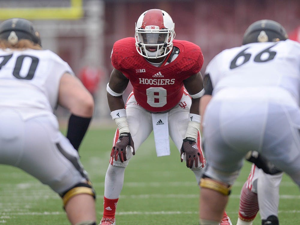Freshman linebacker Tegray Scales anticipates the next play against Purdue on Saturday, Nov. 12, 2014 at Memorial Stadium. Scales was named to the Bednarik Award Watch List on Monday, an award given annually to the top defensive player in college football.