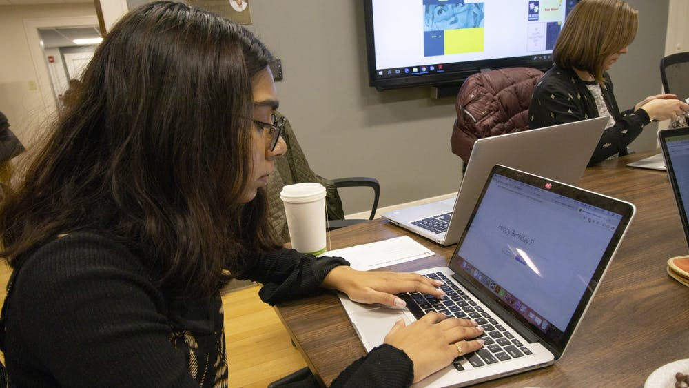 Sophomore Varsha Anand works on an Adobe Spark project Feb. 11 at the Center of Excellence for Women & Technology. At the Galentine's Day Adobe Spark Workshop lead Media Makers intern and Master's student Haley Hatfield demonstrated how to create digital valentines.