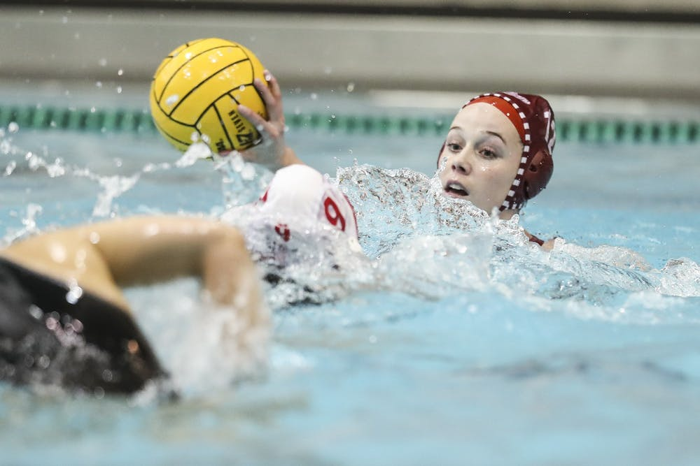 <p>Then-sophomore attacker Tina Doherty makes a pass Jan. 25, 2020, at the Counsilman-Billingsley Aquatics Center. The Hoosiers lost twice this weekend to Stanford in Palo Alto, California. </p>