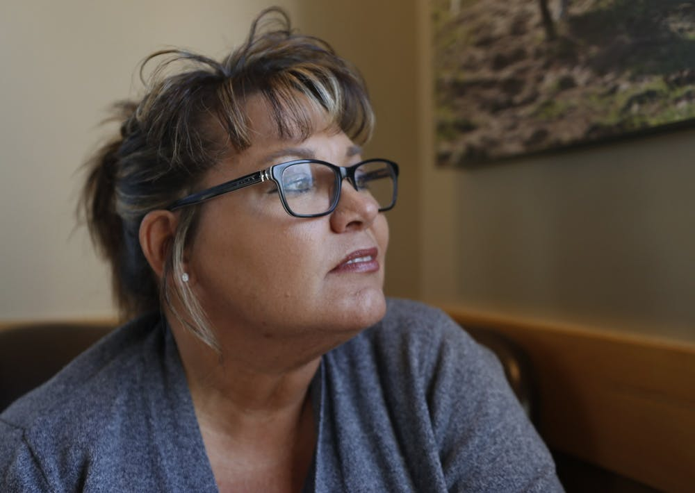 <p>Monica Kelsey looks out a window Nov. 11, 2019 at a Starbucks in Indianapolis. She recounts her limited moments with her birth mother before she died. </p>