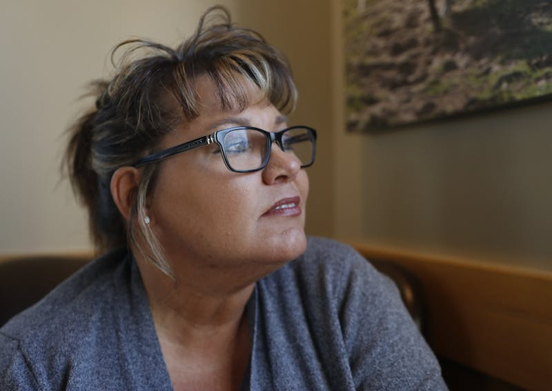 Monica Kelsey looks out a window Nov. 11, 2019 at a Starbucks in Indianapolis. She recounts her limited moments with her birth mother before she died.
