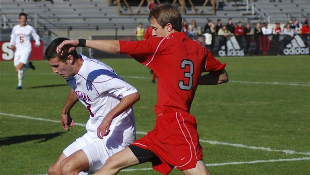Sophomore defender Tommy Meyer avoids Ohio State's Eric Shrigley's foot near the Hoosier goal Sunday at Bill Armstrong Stadium. Both teams remained scoreless in regulation, with the Buckeyes pulling out a 1-0 win in overtime.