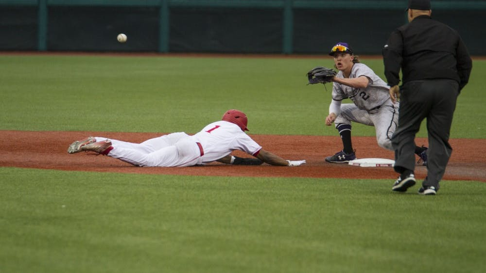 Sophomore infielder Jeremy Houston dives back to second base to be safe from the umpire calling him out. Iagainst Northwestern on April 13. IU lost to Kentucky 7-6 on Tuesday at Bart Kaufman Field.
