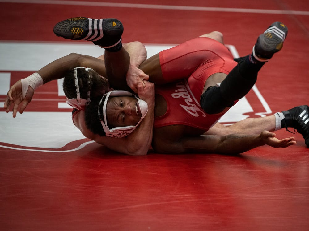 Sophomore Donnell Washington attempts to break free against Nebraska's Mikey Labriola on Feb. 6 at Wilkinson Hall. Washington and redshirt sophomore Graham Rooks placed sixth in their respective weight classes Sunday at the Big Ten Tournament in University Park, Pennsylvania.