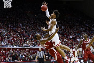 Sophomore forward Justin Smith commits an offensive foul trying to score against the University of Arkansas on March 23 at Simon Skjodt Assembly Hall. IU will play against Wichita State University in the third round of the NIT on March 26.
