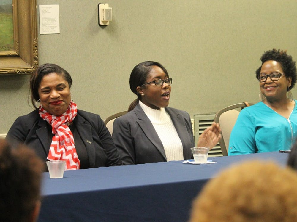(From left to right) Kimberly Gold, Kristen Hicks, and Erica Jones speak at a panel about black women in the STEM field Tuesday evening at the IMU. Topics included were networking, male dominated feilds and higher education.