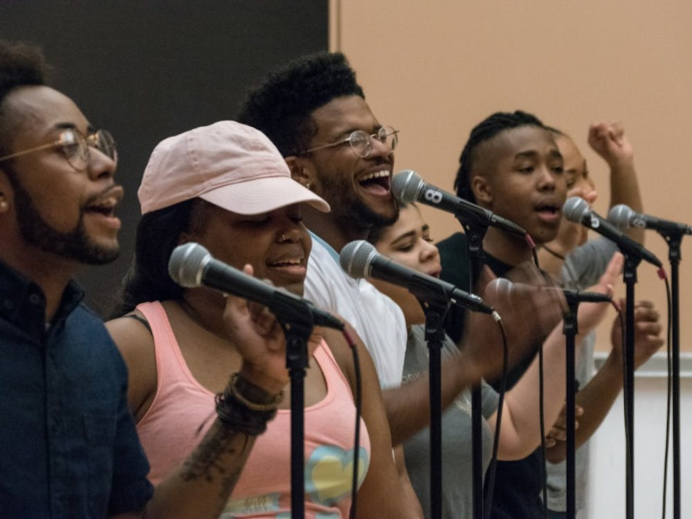 Singers of the IU Soul Revue rehearse in the Neal-Marshall Grand Hall on Monday evening.