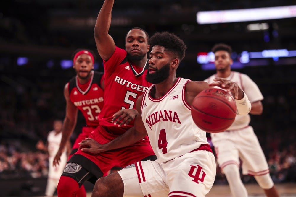<p>Senior guard Robert Johnson dribbles around Rutgers during the Hoosiers' game against the Rutgers Scarlet Knights on Thursday, March 1, during the Big Ten Tournament in Madison Square Garden in New York City. After the season, Johnson participated in the 3X3U Hoops tournament and hit the game-winning shot for the Big Ten.</p>