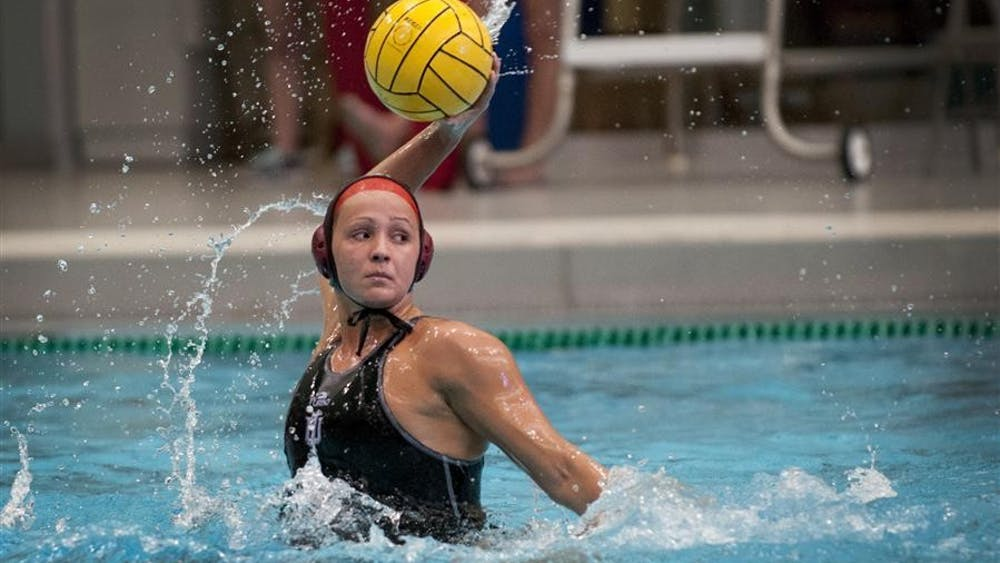 Senior Shae Fournier attempts a shot during IU's game against Wagner on Saturday at the Counsilman-Billingsley Aquatic Center. IU defeated Wagner 11-6, and earned a final spot in the NCAA tournament.