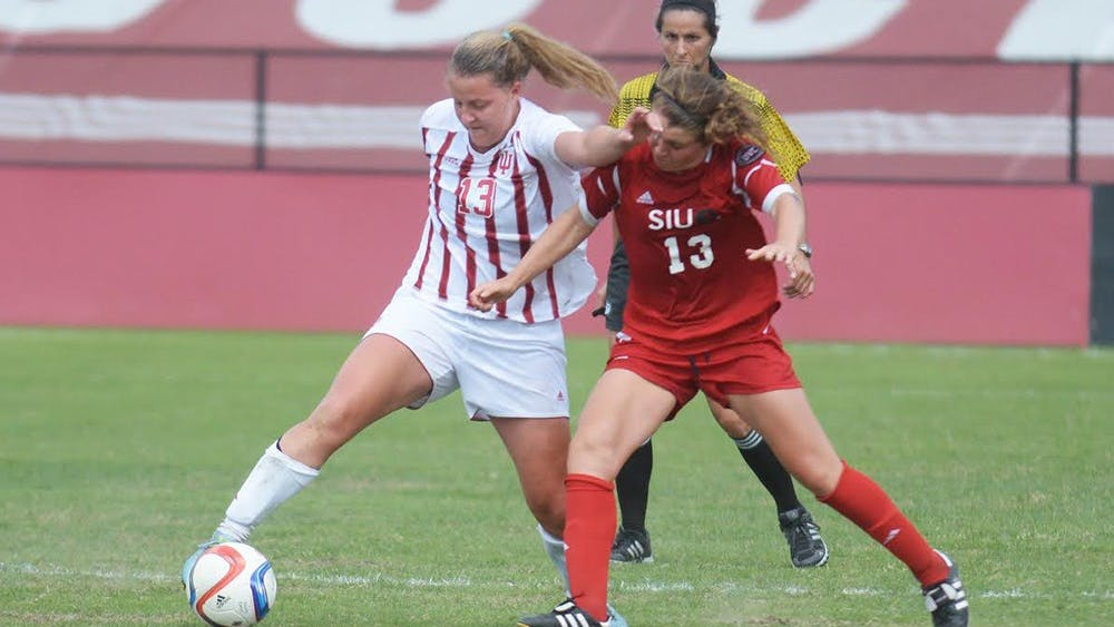 Freshman forward Maya Piper works through the Southern Illinois University Edwardsville Cougars's defense at Bill Armstrong stadium on August 23rd. IU tied the game with the Cougars, 0-0