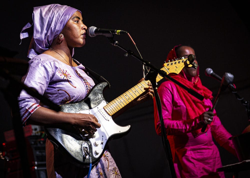 <p>Lead vocalist Fatou Seidi Ghali of the band Les Filles de Illighadad performs Sept. 28, 2019, in the Fourth Street tent during Lotus World Music &amp; Arts Festival. Lotus plans to have the live festival from Sept. 23-26, 2021.</p>