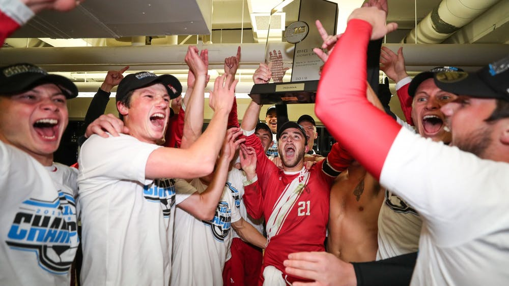 The IU men's soccer team celebrates in the locker room after clinching the Big Ten regular season championship Nov. 3 in East Lansing, Michigan. The Hoosiers received 12 Big Ten postseason awards.