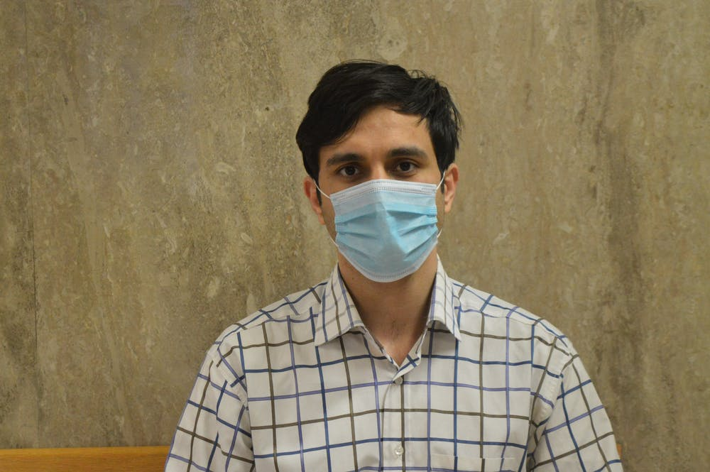 <p>Abolfazl Alipour, 29, poses for a photo with a mask. Alipour is a supporter of the Indiana Graduate Workers Coalition who also joined the 2021 Committee for Fee Review. </p>
